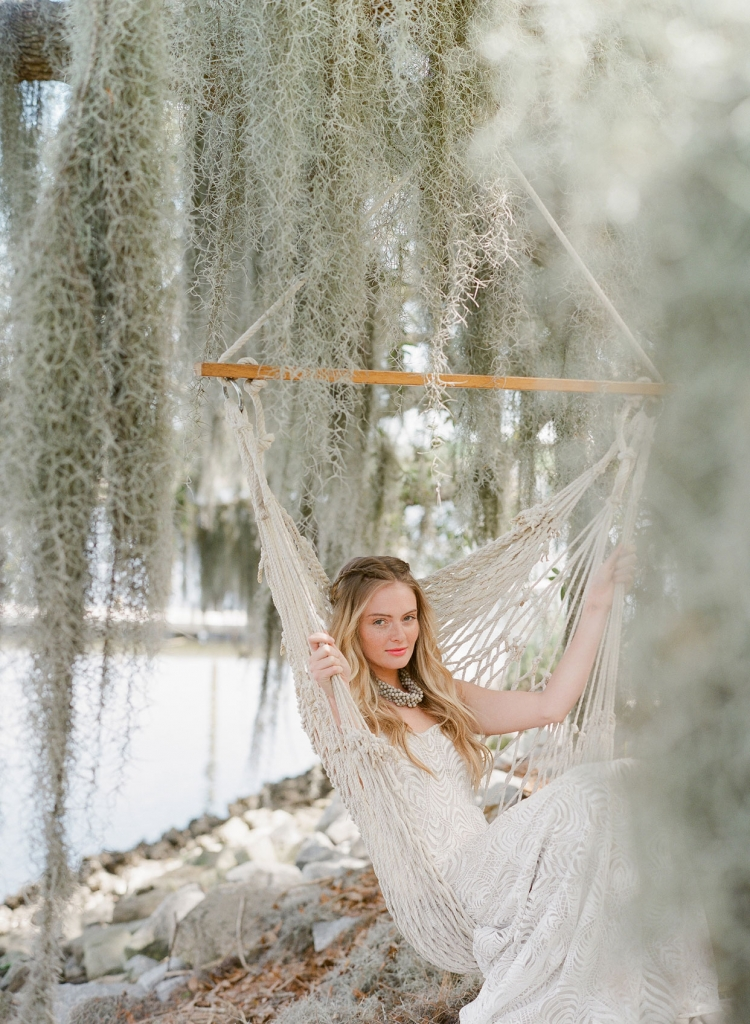 "Katherine McDonald's ""Hemingway"" gown from Kate McDonald Bridal and Lovely Bride. Ann Lightfoot necklace from RTW. Hammock chair from Fox Events"