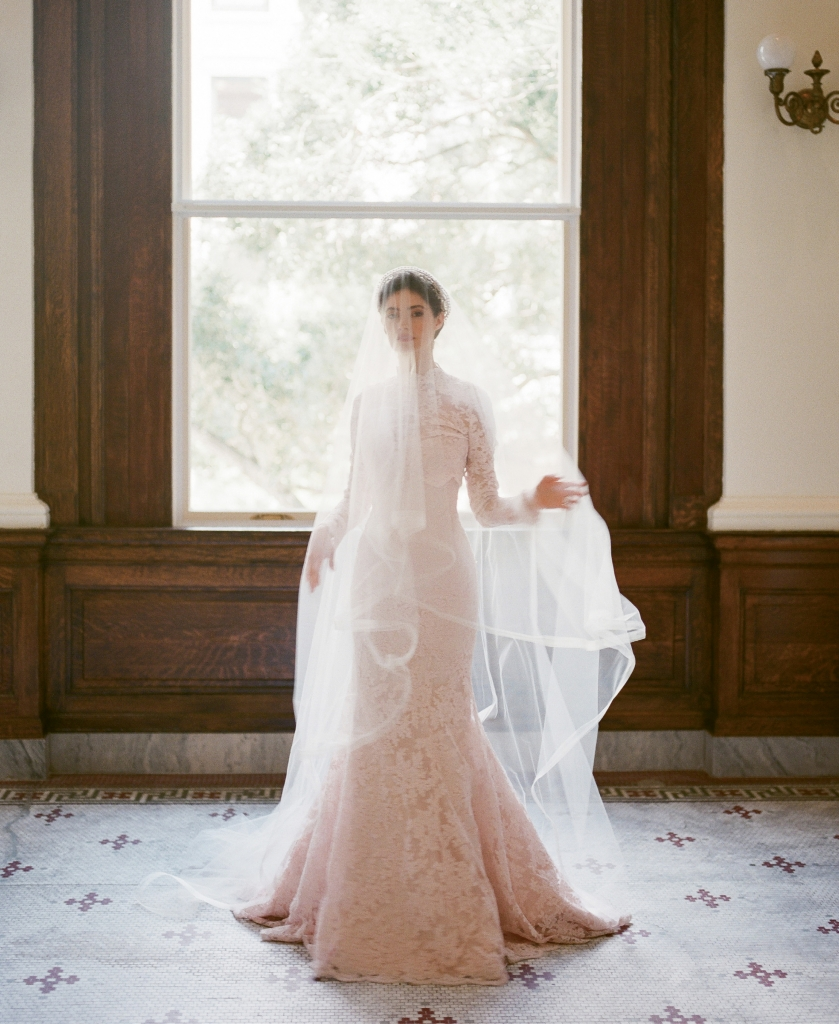 "Legends Romona Keveza's L7125 rose lace fit-to-flare gown with illusion blouse, both from Maddison Row. Photographer's vintage crown. Untamed Petals' ""Cypress"" veil from Lovely. (Photo by Corbin Gurkin)"