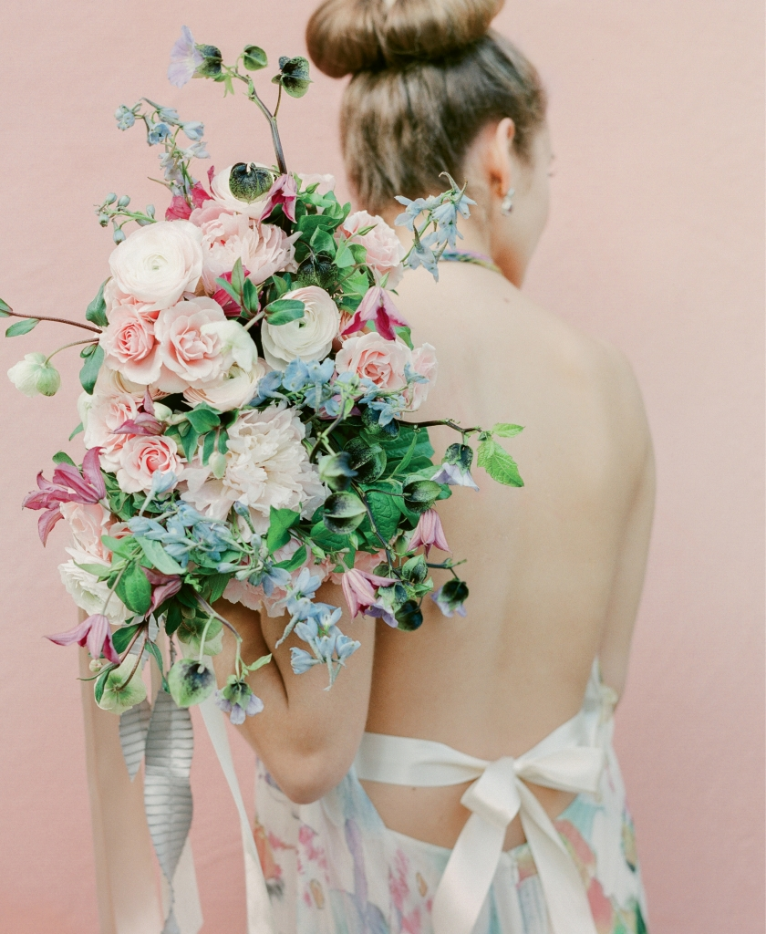 "Theia's ""Fae"" silk floral halter gown from Fabulous Frocks. Chatelain Collection by David Yurman's silver, amethyst, and topaz earrings from REEDS Jewelers. Bouquet by Gathering Floral + Event Design."