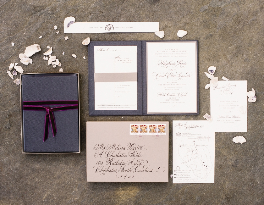 Invitations, hand-delivered to each guest, were tied with velvet ribbon in a rich shade of Bordeaux.  Stationery by Studio R Design. Calligraphy by Elizabeth Porcher Jones. Image by Timwill Photography.