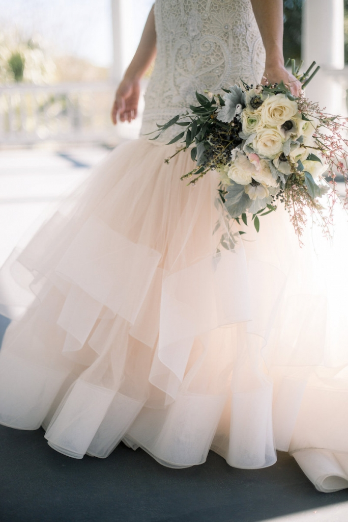 Bride's gown by Lazaro (available locally at Gown Boutique of Charleston). Florals by Stems Floral Design by Jonie Larosee. Image by Timwill Photography.