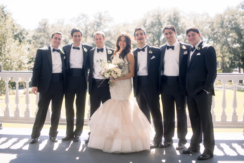 Bride's gown by Lazaro (available locally at Gown Boutique of Charleston). Menswear by Jos. A. Bank. Florals by Stems Floral Design by Jonie Larosee. Image by Timwill Photography.
