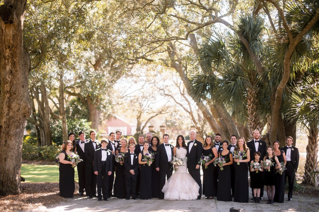 Bride's gown by Lazaro (available locally at Gown Boutique of Charleston). Bridesmaids' dresses by Ralph Lauren. Menswear by Jos. A. Bank. Florals by Stems Floral Design by Jonie Larosee. Image by Timwill Photography at Lowndes Grove Plantation.