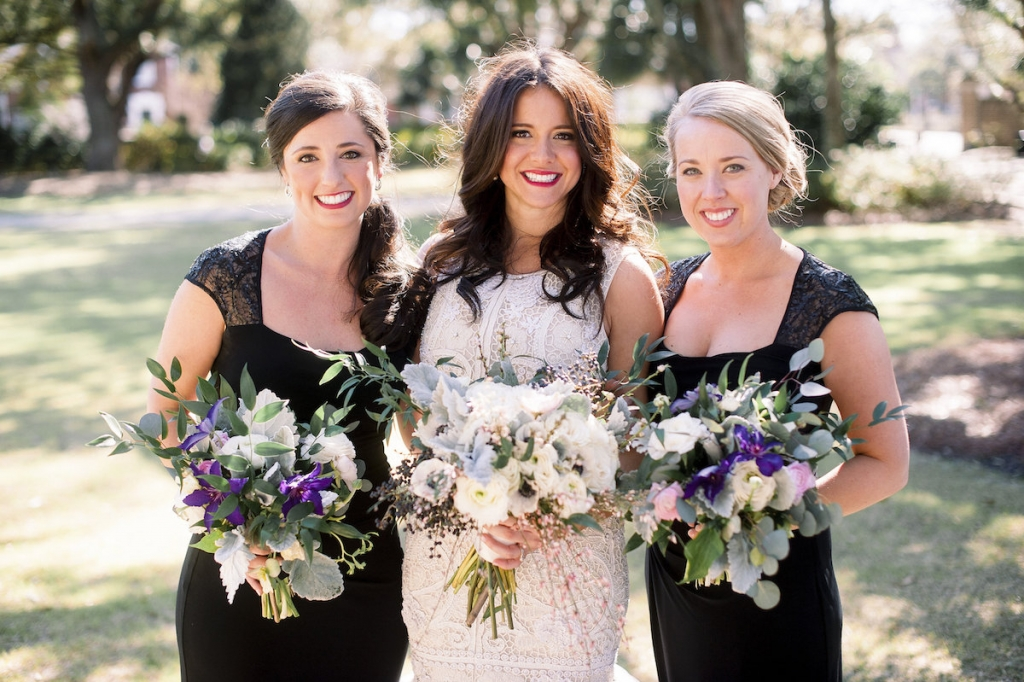 Bride's gown by Lazaro (available locally at Gown Boutique of Charleston). Bridesmaids' dresses by Ralph Lauren. Florals by Stems Floral Design by Jonie Larosee. Image by Timwill Photography.