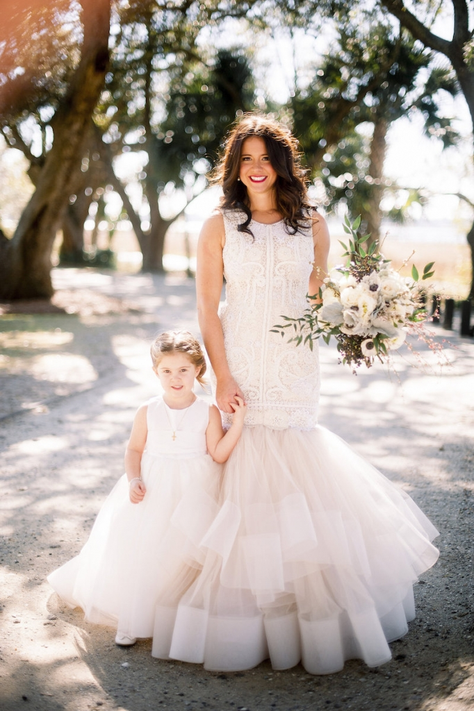 Bride's gown by Lazaro (available locally at Gown Boutique of Charleston). Florals by Stems Floral Design by Jonie Larosee. Image by Timwill Photography at Lowndes Grove Plantation.