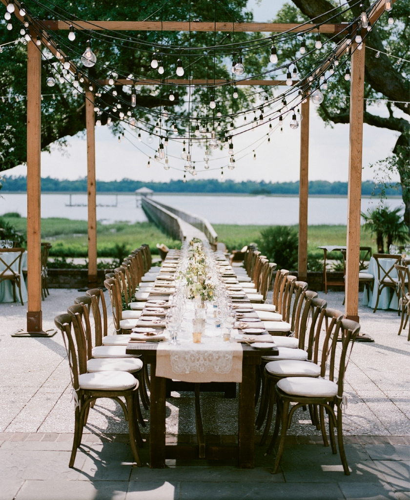 Photograph by Hyer Images at Lowndes Grove Plantation. Design by Loluma. Rentals by Snyder Event Rentals. Lighting by Technical Event Company.