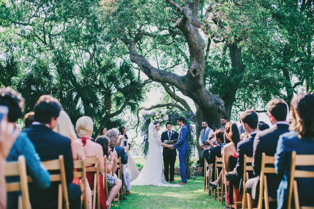 Photograph by Hyer Images at Lowndes Grove Plantation. Floral arch by Loluma.