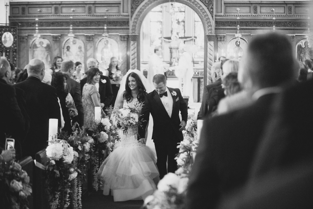 Bride's gown by Lazaro (available locally at Gown Boutique of Charleston). Florals by Stems Floral Design by Jonie Larosee. Image by Timwill Photography at the Greek Orthodox Church of the Holy Trinity.