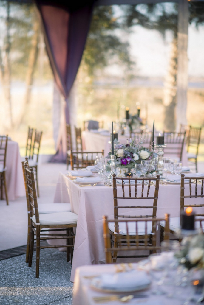 Wedding design by A Charleston Bride. Tables, chairs, china and stemware from Snyder Events. Linens from BBJ Linens. Florals by Stems Floral Design by Jonie Larosee. Image by Timwill Photography.