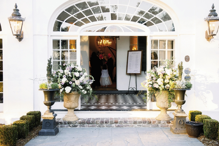 To find just the right flowers at the tail end of winter meant flying blooms in from Holland, Japan, Israel, and Australia. Two enormous arrangements guided guests to the entrance of the reception.  Florals by Stems Floral Design by Jonie Larosee. Image by Timwill Photography at Lowndes Grove Plantation.