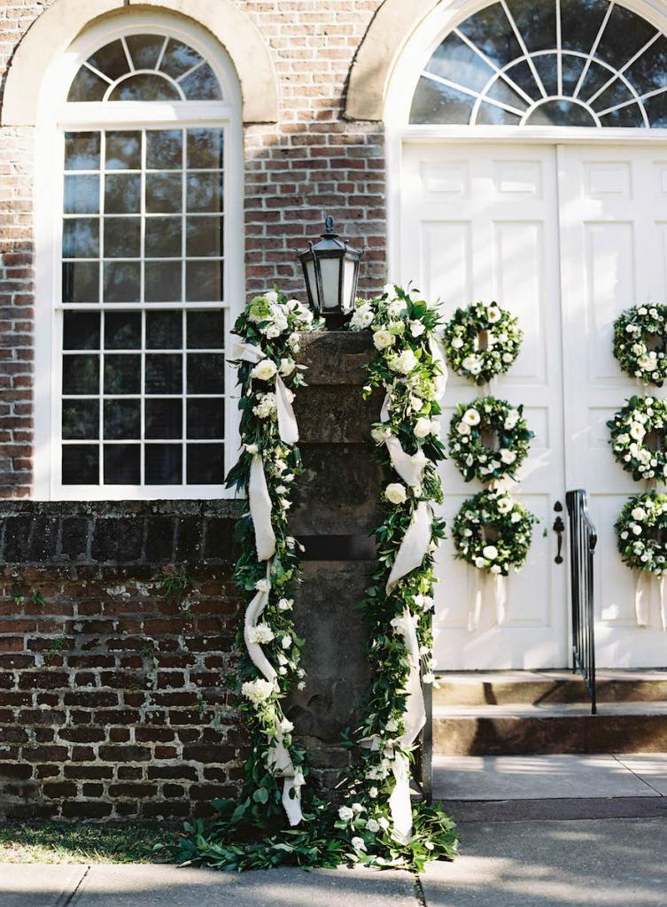 Florals by Blossoms Events. Photograph by Tec Petaja at Prince George Winyah Episcopal Church.