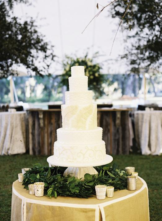 Catering to reception-goers' varied tastes (and the bride's major sweet tooth), Wedding Cakes by Jim Smeal baked a six-tier beaut featuring chocolate, almond, and coconut flavors. Cake by Wedding Cakes by Jim Smeal. Florals by Blossoms Events. Photograph by Tec Petaja.