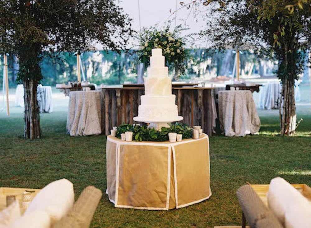Cake by Wedding Cakes by Jim Smeal. Florals by Blossoms Events. Photograph by Tec Petaja.