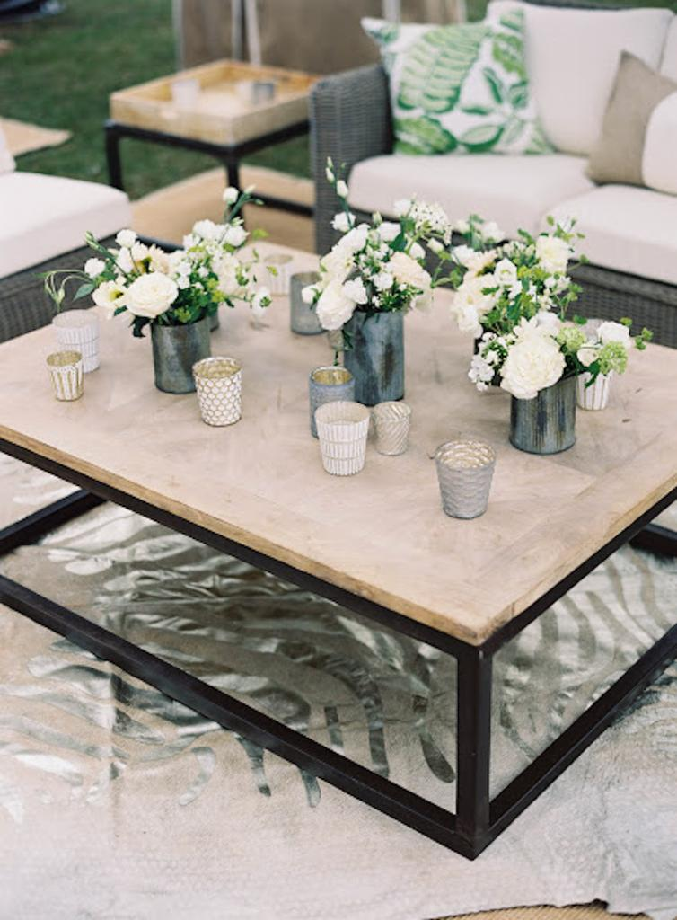 Wedding design and lounge rentals by Calder Clark. Florals by Blossoms Events. Photograph by Tec Petaja.
