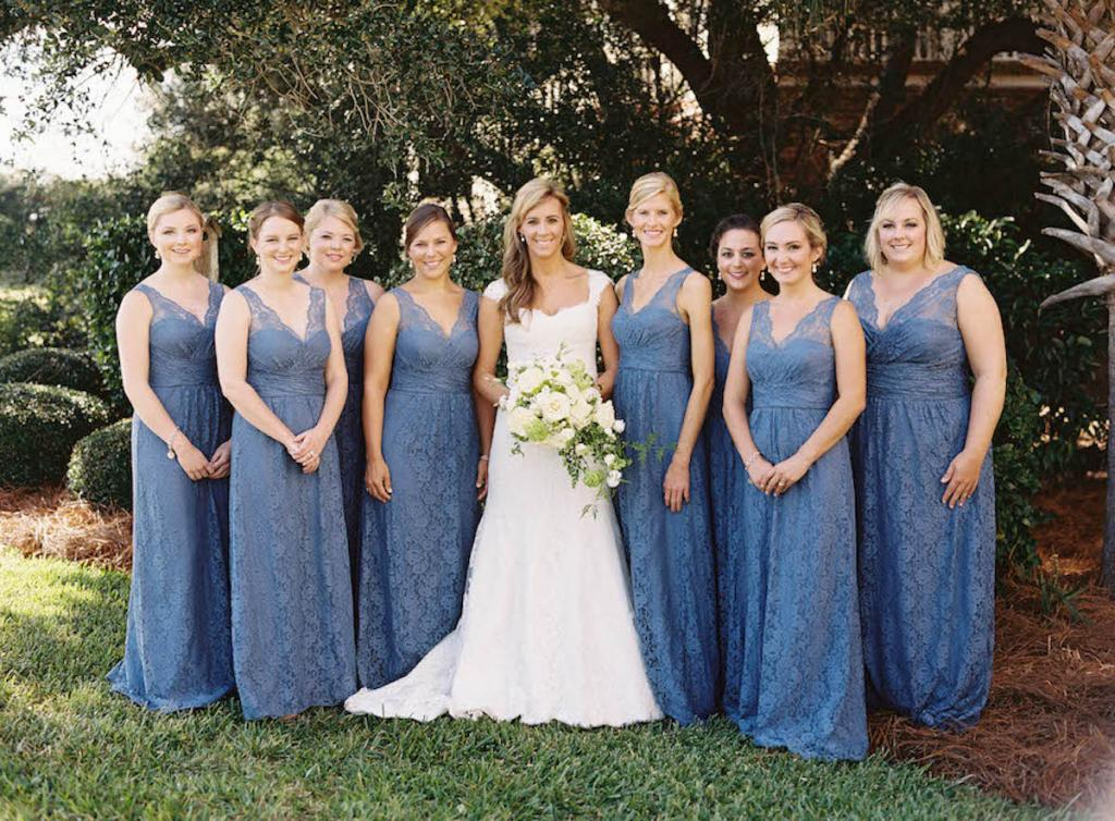 Bridesmaid dresses echoed the blue hue of the Scotch plaid seen throughout the décor. Bride's gown by Monique Lhuillier (available locally at Maddison Row). Bridesmaids' dresses by Amsale (available locally at Bella Bridesmaids). Hair by Stuart Laurence Salon. Makeup by Kelly Martuscello. Florals by Blossoms Events. Photograph by Tec Petaja.