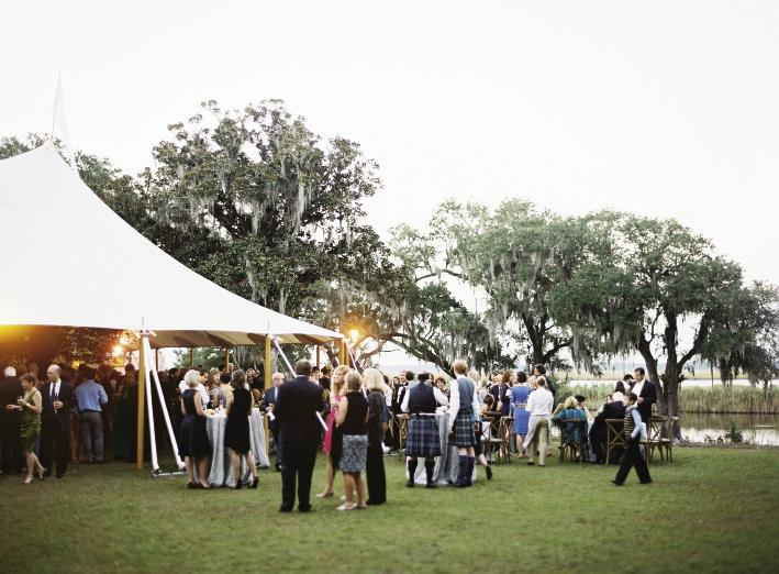 Though many of John's relatives have wed at Estherville, he and Hollis were the first to celebrate on the property's front lawn, which overlooks Winyah Bay. Tent by Sperry Tents Southeast. Photograph by Tec Petaja.