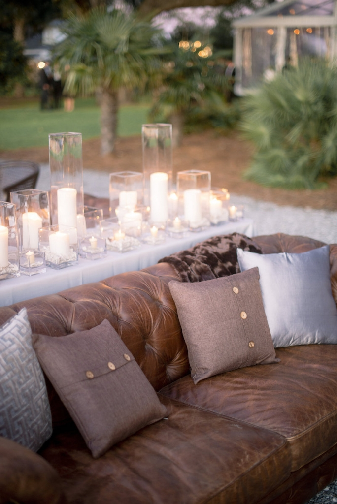 Wedding design by A Charleston Bride. Lounge area sofas by Snyder Events. Image by Timwill Photography.