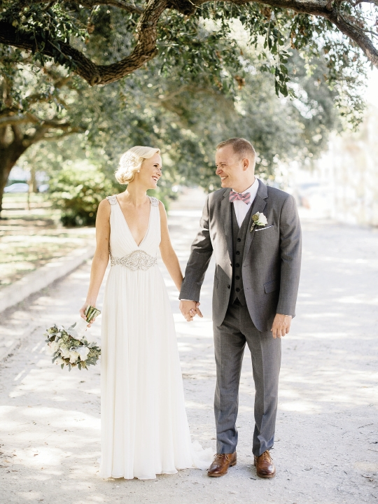 Bride's gown by Jenny Packham (available locally through White on Daniel Island). Beauty by Wedding Hair by Charlotte. Menswear by Bonobos. Bow ties by High Cotton. Bouquet by Out of the Garden. Image by Brandon Lata Photography at Boone Hall Plantation and Cotton Dock.