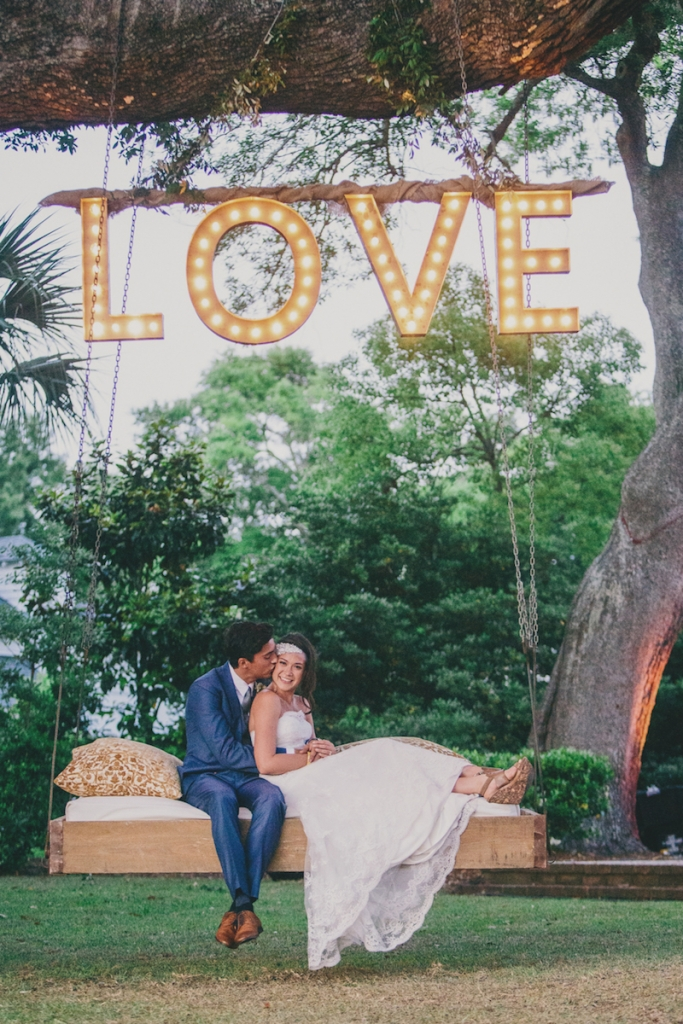 Photograph by Hyer Images at Lowndes Grove Plantation. Love sign by Loluma. Swing by Ooh! Events.