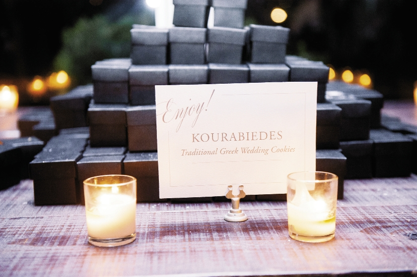 Cookies baked by Stephanie's childhood Greek school teacher and boxed by her mother and grandmother were offered as favors. Wedding design by A Charleston Bride. Signage by Studio R Designs. Image by Timwill Photography.
