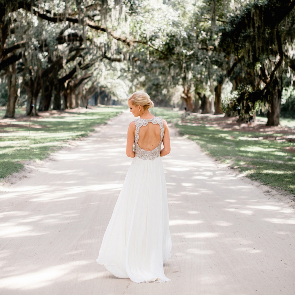 Bride's gown by Jenny Packham (available locally through White on Daniel Island). Beauty by Wedding Hair by Charlotte. Image by Brandon Lata Photography at Boone Hall Plantation and Cotton Dock.