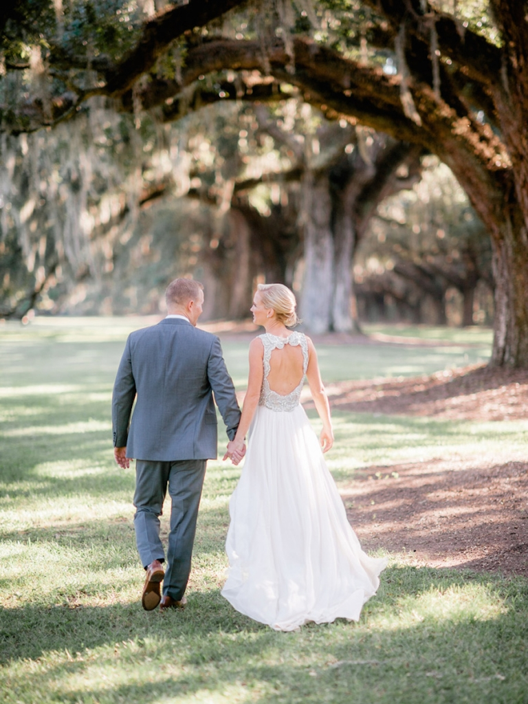 Bride's gown by Jenny Packham (available locally through White on Daniel Island). Menswear by Bonobos. Image by Brandon Lata Photography at Boone Hall Plantation and Cotton Dock.