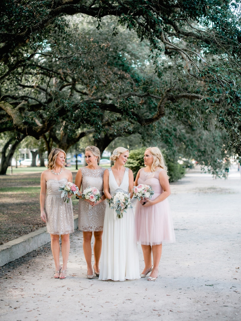 Bridesmaids' dresses by Jenny Yoo (available locally through Bella Bridesmaids and Fabulous Frocks) and BHLDN. Bride's gown by Jenny Packham (available locally through White on Daniel Island). Bouquets by Out of the Garden. Image by Brandon Lata Photography at Boone Hall Plantation and Cotton Dock.