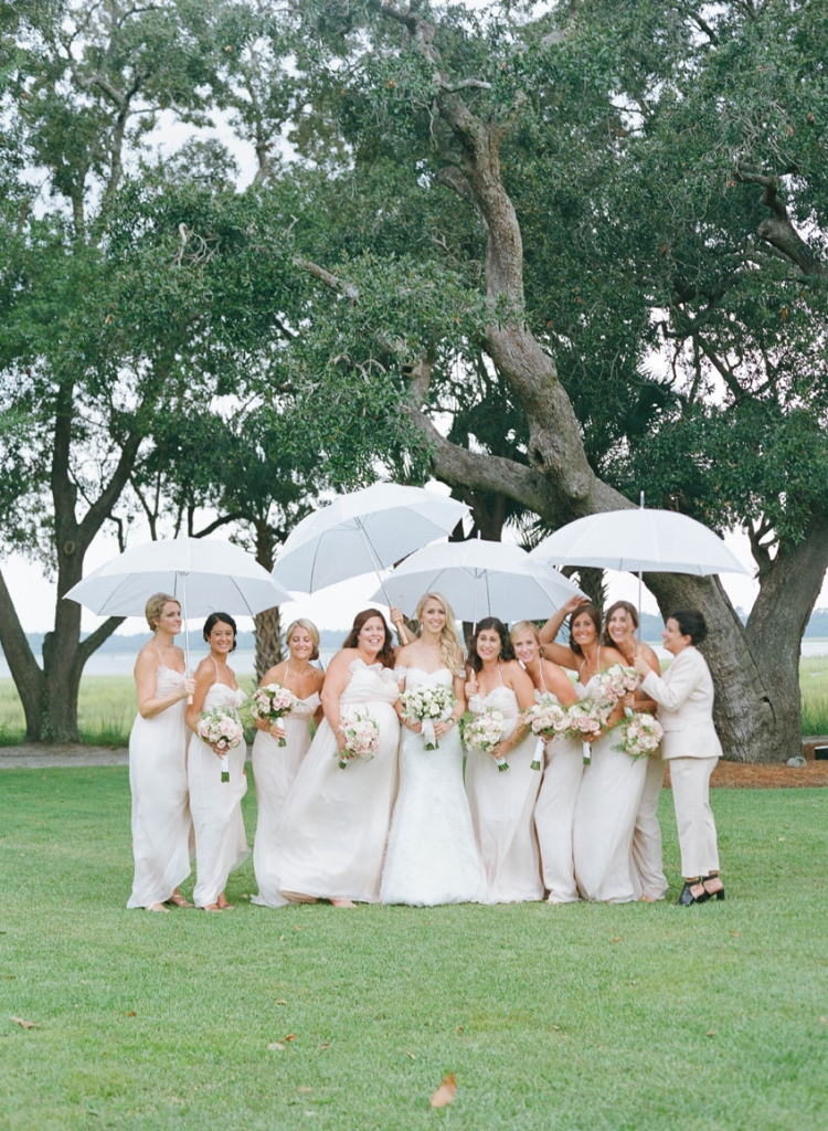 Bride's gown by Monique Lhuillier, available in Charleston through Maddison Row. Bridesmaid gowns by Amsale, available in Charleston through Bella Bridesmaids. Bridesmaid's suit by BCBG. Photograph by Elizabeth Messina at Lowndes Grove Plantation.