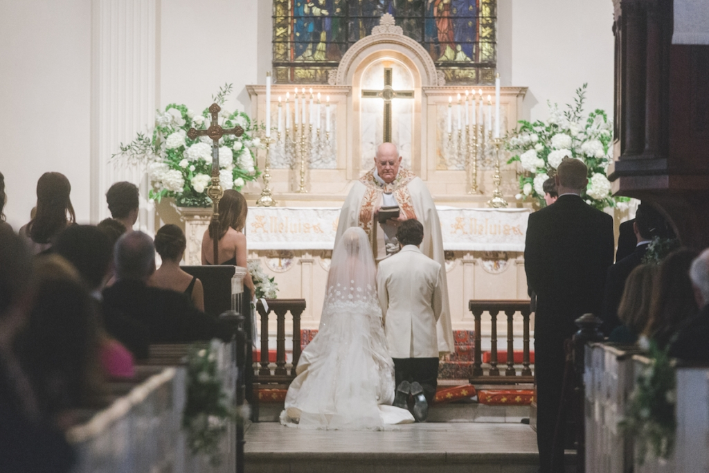 Bride's gown and veil by Oscar de la Renta. Menswear by Grady Ervin & Co. Florals by Gathering Floral + Event Design. Image by Elisabeth Millay Photography at St. Philips Church.