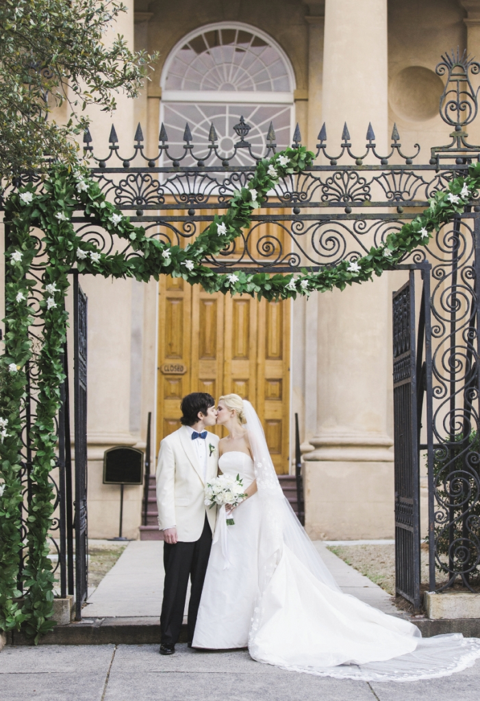 Bride's gown by Oscar de la Renta. Menswear by Grady Ervin & Co. Florals by Gathering Floral + Event Design. Image by Elisabeth Millay Photography at St. Philips Church.