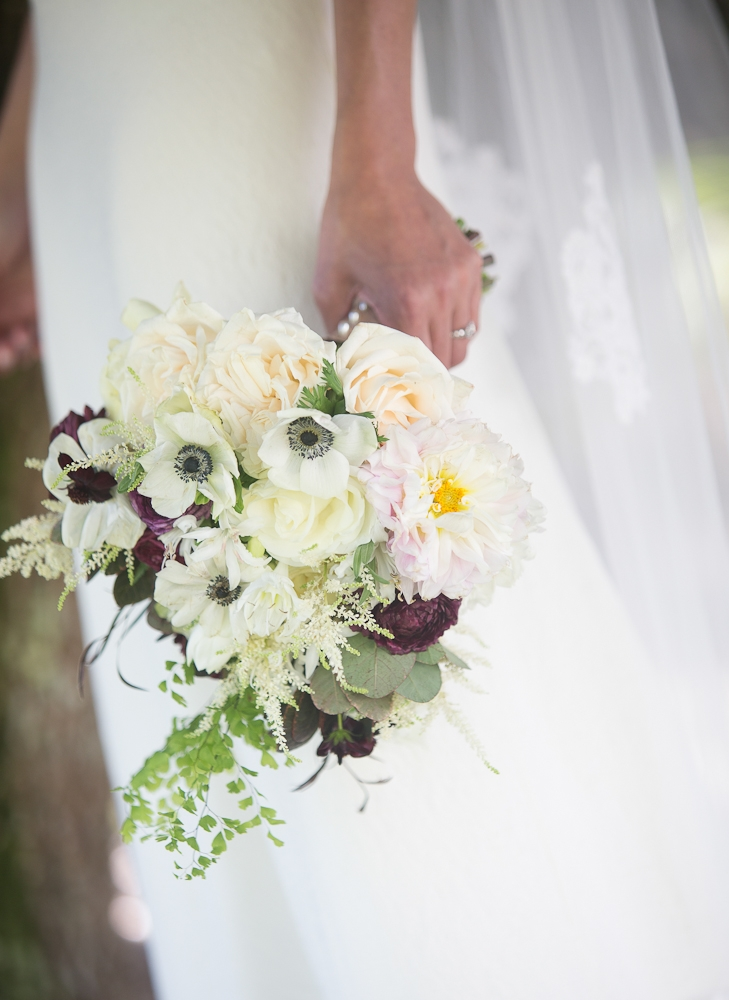 Bride's gown by Delphine Manivet. Florals by Charleston Stems. Photograph by Captured by Kate..