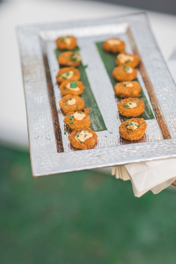 "Small plates and passed hors d'oeuvres made the evening feel more like a party and not ""like a dinner with a little dancing,"" says Laura.  Catering by Patrick Properties Hospitality Group. Image by Elisabeth Millay Photography."