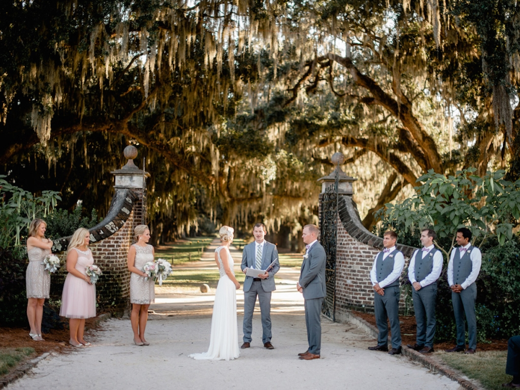 Bridesmaids' dresses by Jenny Yoo (available locally through Bella Bridesmaids and Fabulous Frocks) and BHLDN. Menswear by Bonobos. Image by Brandon Lata Photography at Boone Hall Plantation and Cotton Dock.