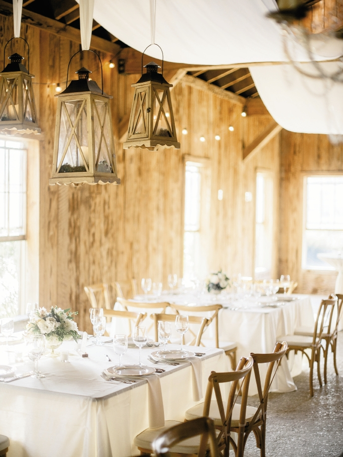 Wedding design and rentals by Ooh! Events. Florals by Out of the Garden. Image by Brandon Lata Photography at Boone Hall Plantation and Cotton Dock.
