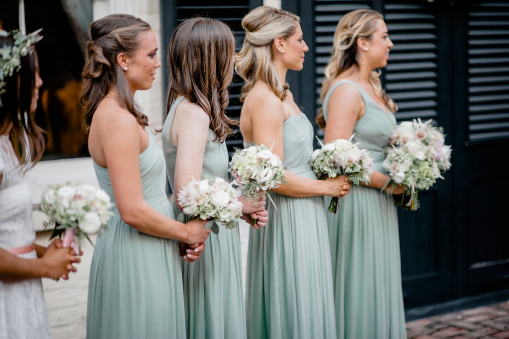 Bridesmaid gowns from J.Crew. Florals by Out of the Garden. Photograph by Brandon Lata at the William Aiken House.