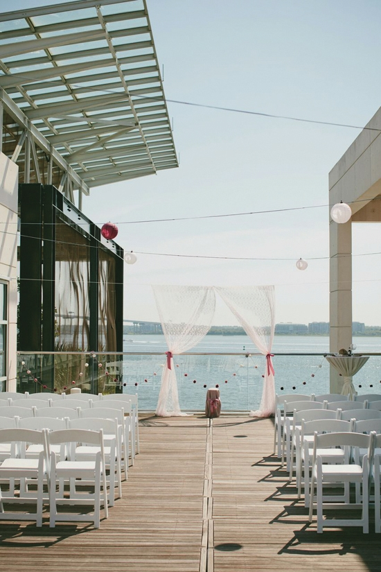 """SUNDAY FUNDAY: Ruth and Thomas envisioned a small wedding by the water, and the rooftop deck of the South Carolina Aquarium was a perfect match. Choosing to have it on a Sunday morning, Ruth says, """"made things a little bit cheaper."""""""
