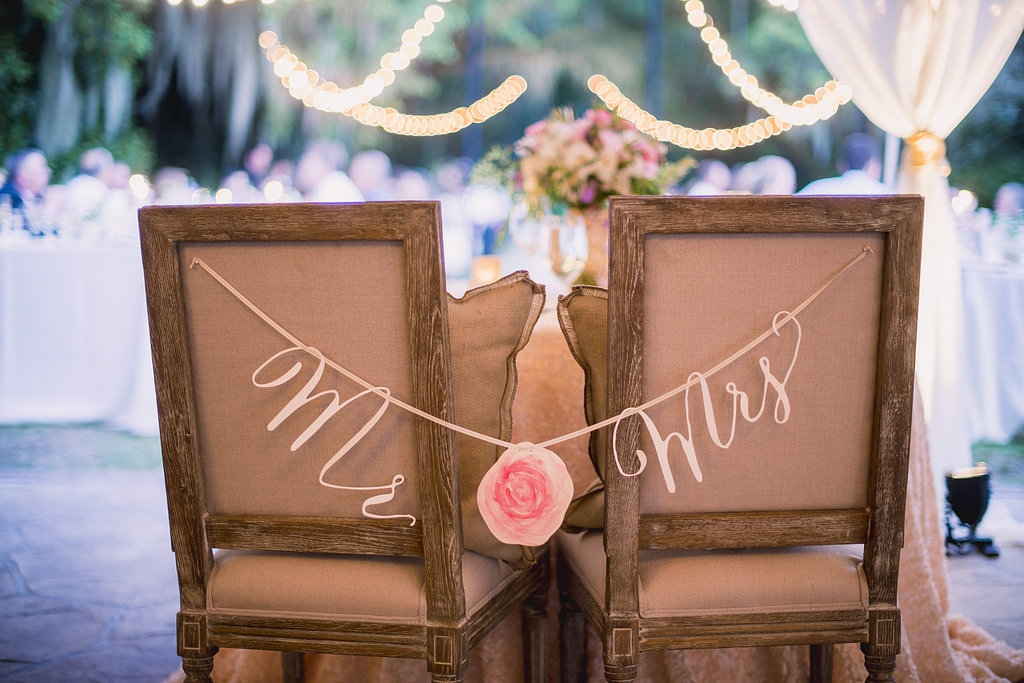 Wedding design by Sweetgrass Social Event + Design. Chairs from EventWorks. Signage by Blue Glass Designs.Image by Timwill Photography.