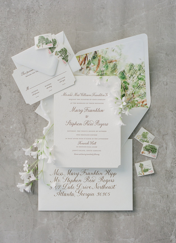 Remember envelope liners can add a burst of color. Watercolors evoking oaks and Spanish moss harkened the wedding site's landscape.