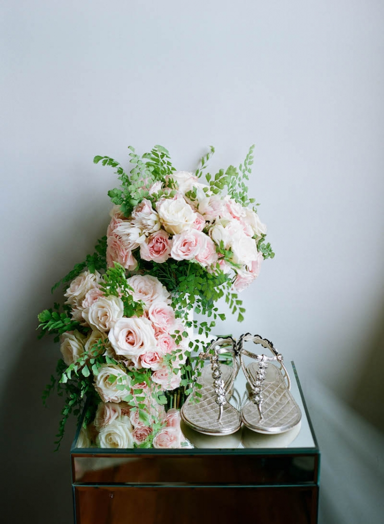 Florals by Tara Guérard Soirée. Bride's shoes by Chanel. Photograph by Elizabeth Messina.