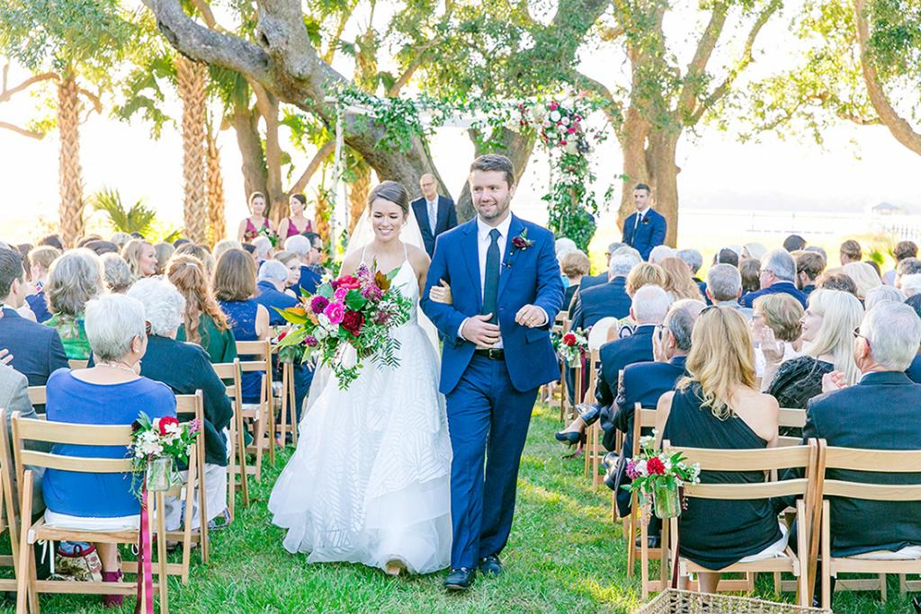 """Picture yourself walking down the aisle. """"I imagined how fun bold, bright flowers would look playing off of my white dress,"""" says Caroline."""