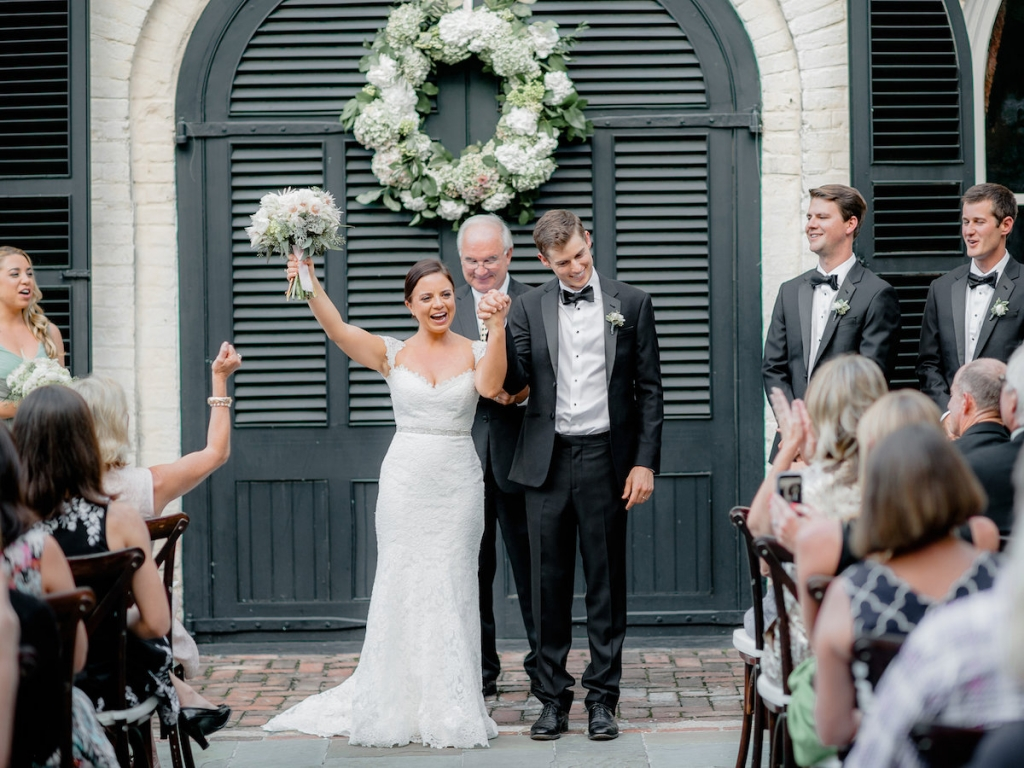 Wedding design by Ooh! Events. Bride's gown by Romona Keveza, available in Charleston through Maddison Row. Groom's attire from The Black Tux. Photograph by Brandon Lata at the William Aiken House.