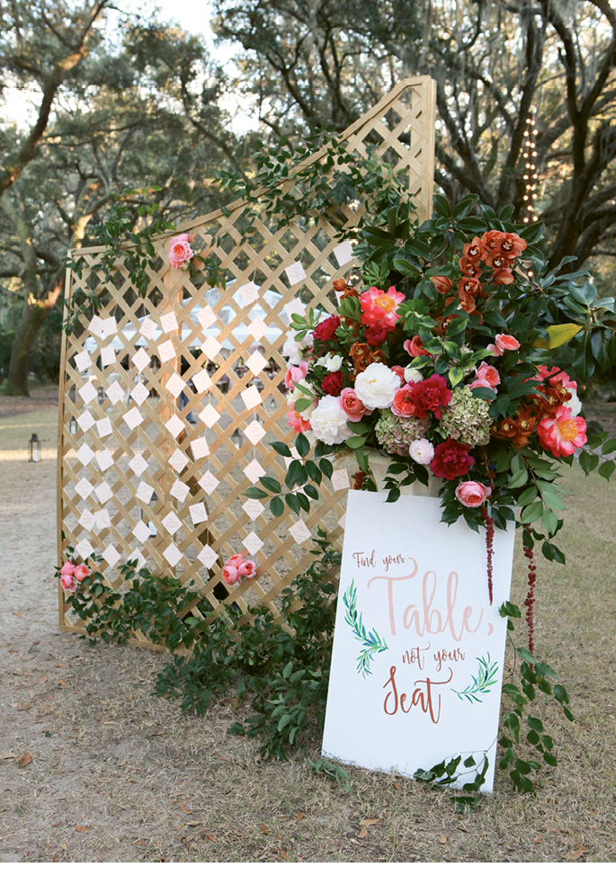A pair of simple wooden lattices, painted a shimmering gold and placed  at the entrance to the reception, formed a place card station.   <i>Photograph Jennifer Bearden</i>