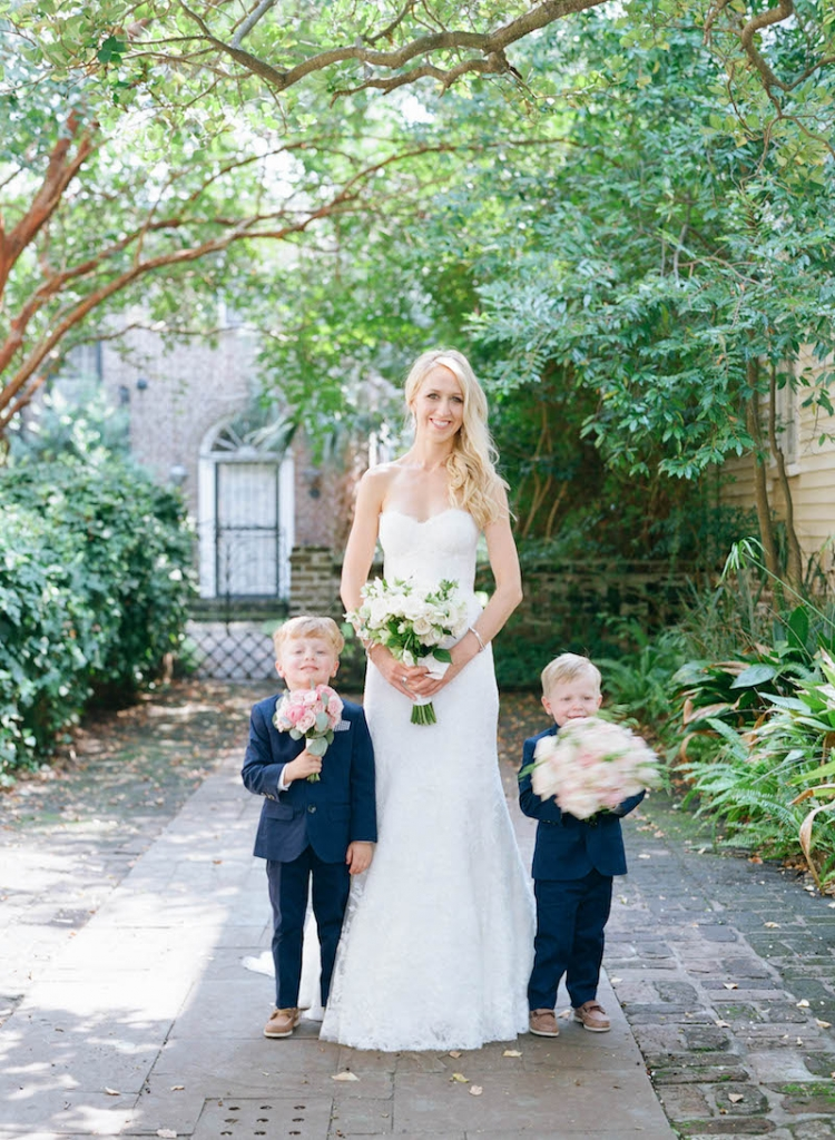 Bride's gown by Monique Lhuillier, available in Charleston through Maddison Row. Day-of gown preparation by Cacky's Bride + Aid. Ring bearers' attire from J.Crew. Florals by Tara Guérard Soirée. Photograph by Elizabeth Messina.