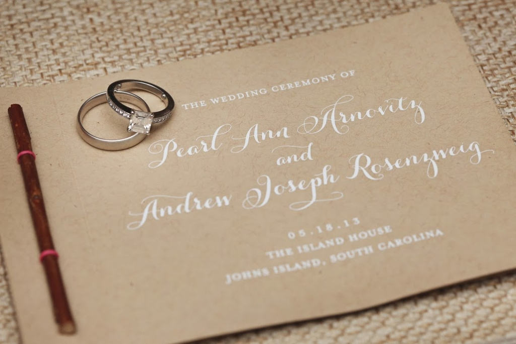 TIE ONE ON: To add a hint of the wedding's palette to the stationery suite, Atlanta's Brighten My Day used hot pink string to secure a rustic twig to wedding invitations.