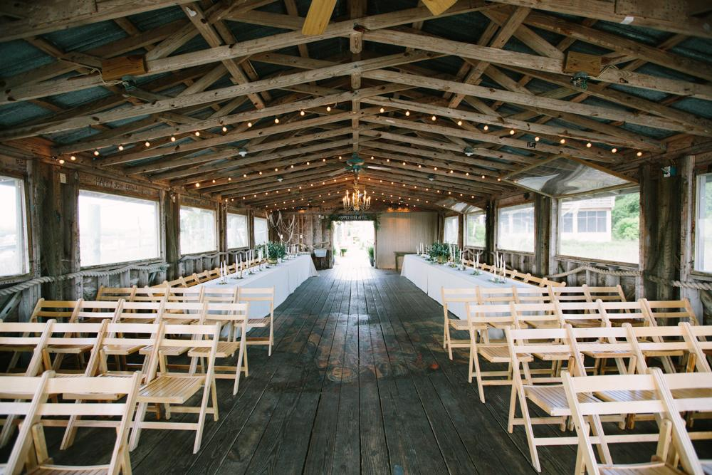 Wedding design by bride. Chairs from Snyder Events. Image by Susan Dean Photography at Bowens Island Restaurant.