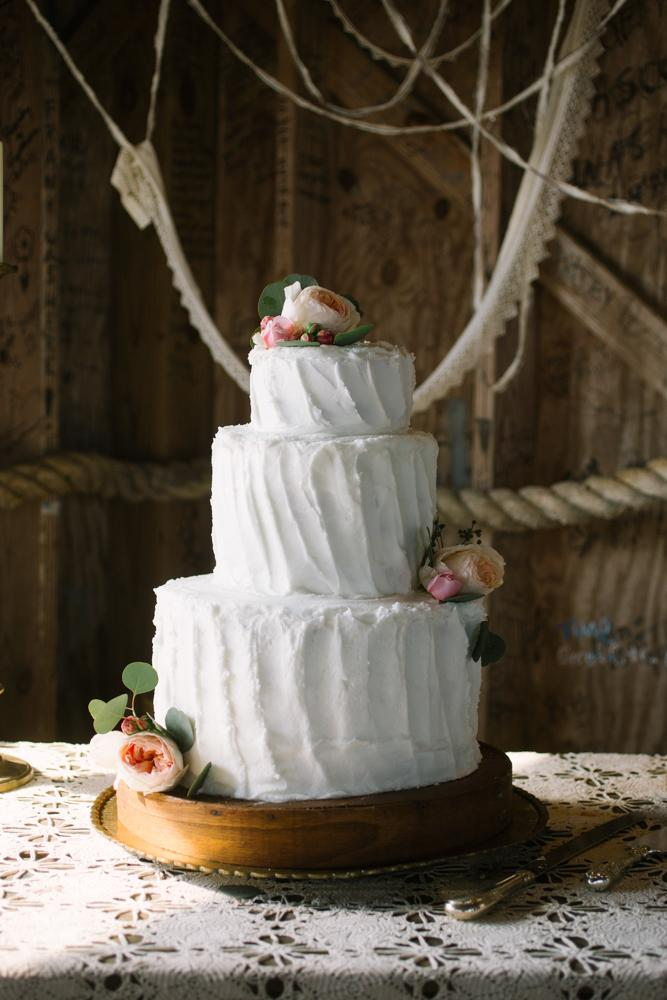 Cake by bride's mother. Wedding design by bride. Image by Susan Dean Photography at Bowens Island Restaurant.