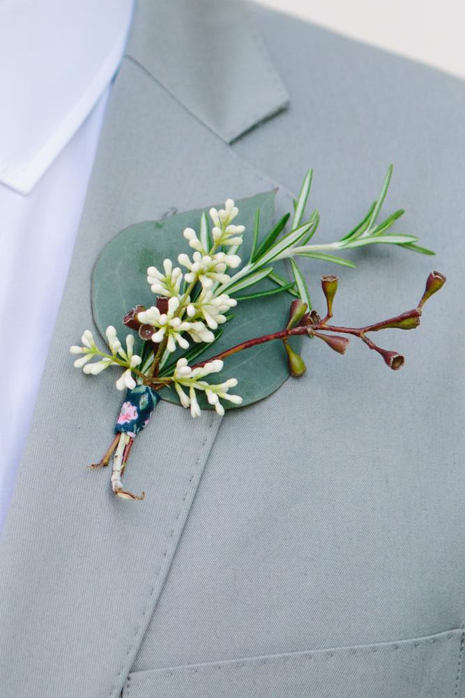 Boutonnière by bride and friends. Image by Susan Dean Photography.