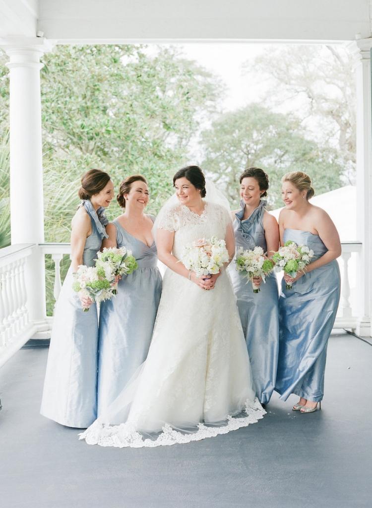 Photograph by Corbin Gurkin. Bride's attire by Oscar de la Renta. Bridesmaids' attire by LulaKate. Bouquets by Blossoms Events.
