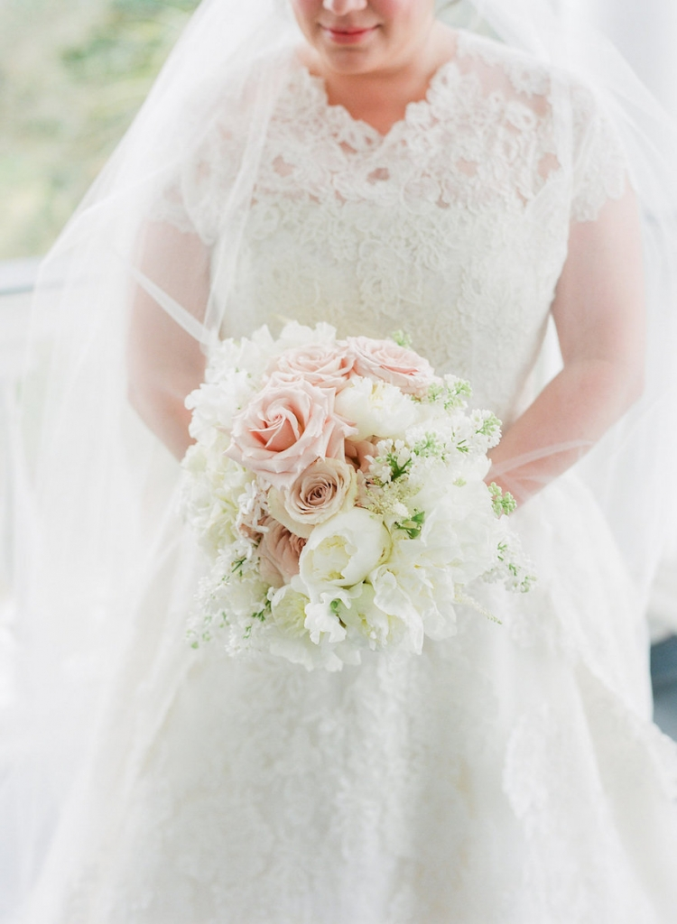Photograph by Corbin Gurkin. Bride's attire by Oscar de la Renta. Bouquet by Blossoms Events.