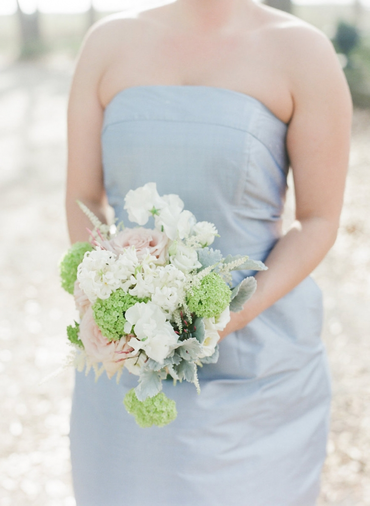 Photograph by Corbin Gurkin. Bridesmaid's attire by LulaKate. Bouquet by Blossoms Events.